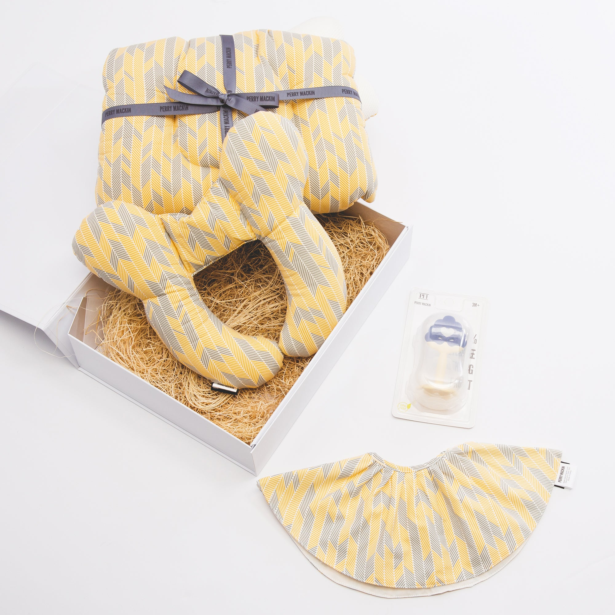 yellow baby bib, teether, neck pillow set