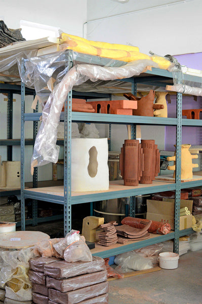 collection of creations by Léa Munsch on a ceramic drying cart