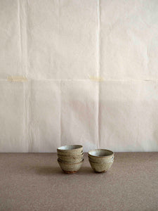 set of different handmade small ceramic bowls at M AAH