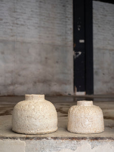 duo of two ceramic objects made from natural clay with a rough texture by Jérôme Hirson