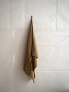 qualitative washed linen dish towel by Linger Particulier in mustard colour