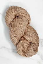 Load image into Gallery viewer, hand-dyed yarn in a semi-solid colorway, tan with the faintest hint of pink overtone