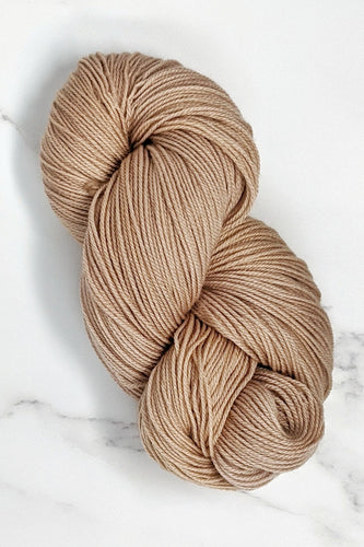hand-dyed yarn in a semi-solid colorway, tan with the faintest hint of pink overtone