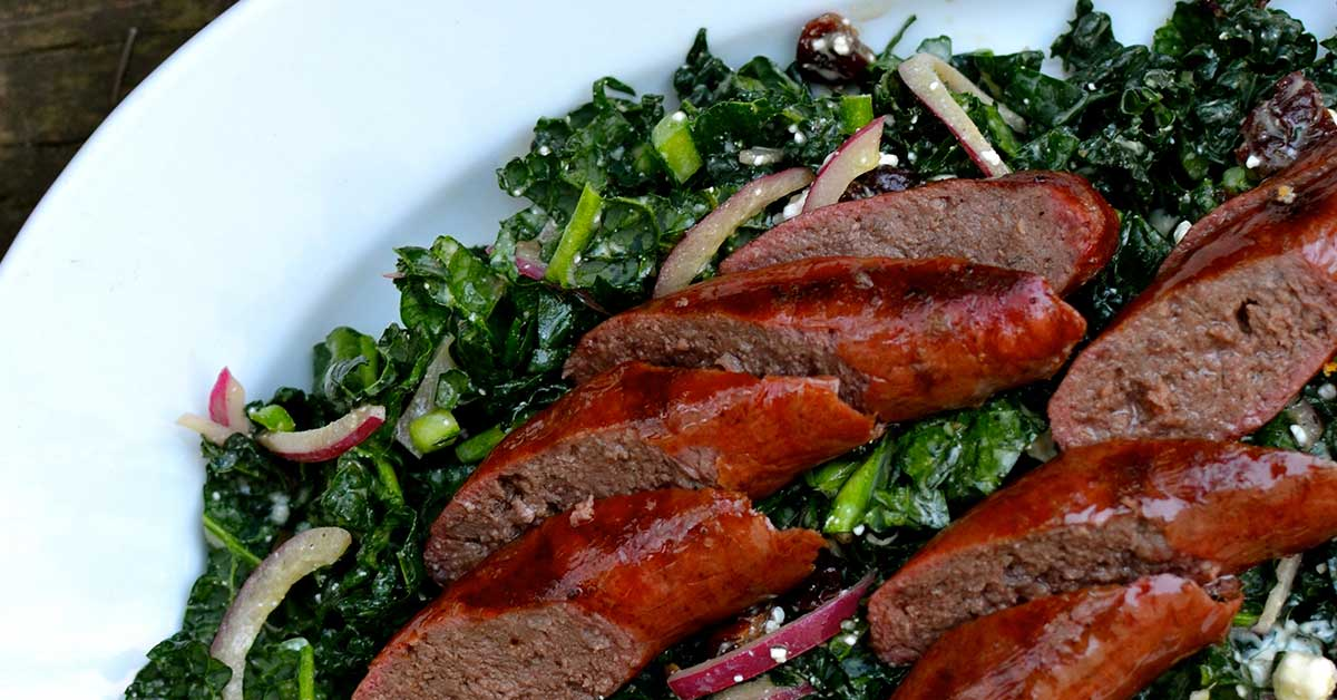 Kale Salad with Grilled Wagyu Beef Sausage and Dried Cherries
