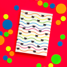 Load image into Gallery viewer, White journal with wavy rainbow pinstripes and black cats