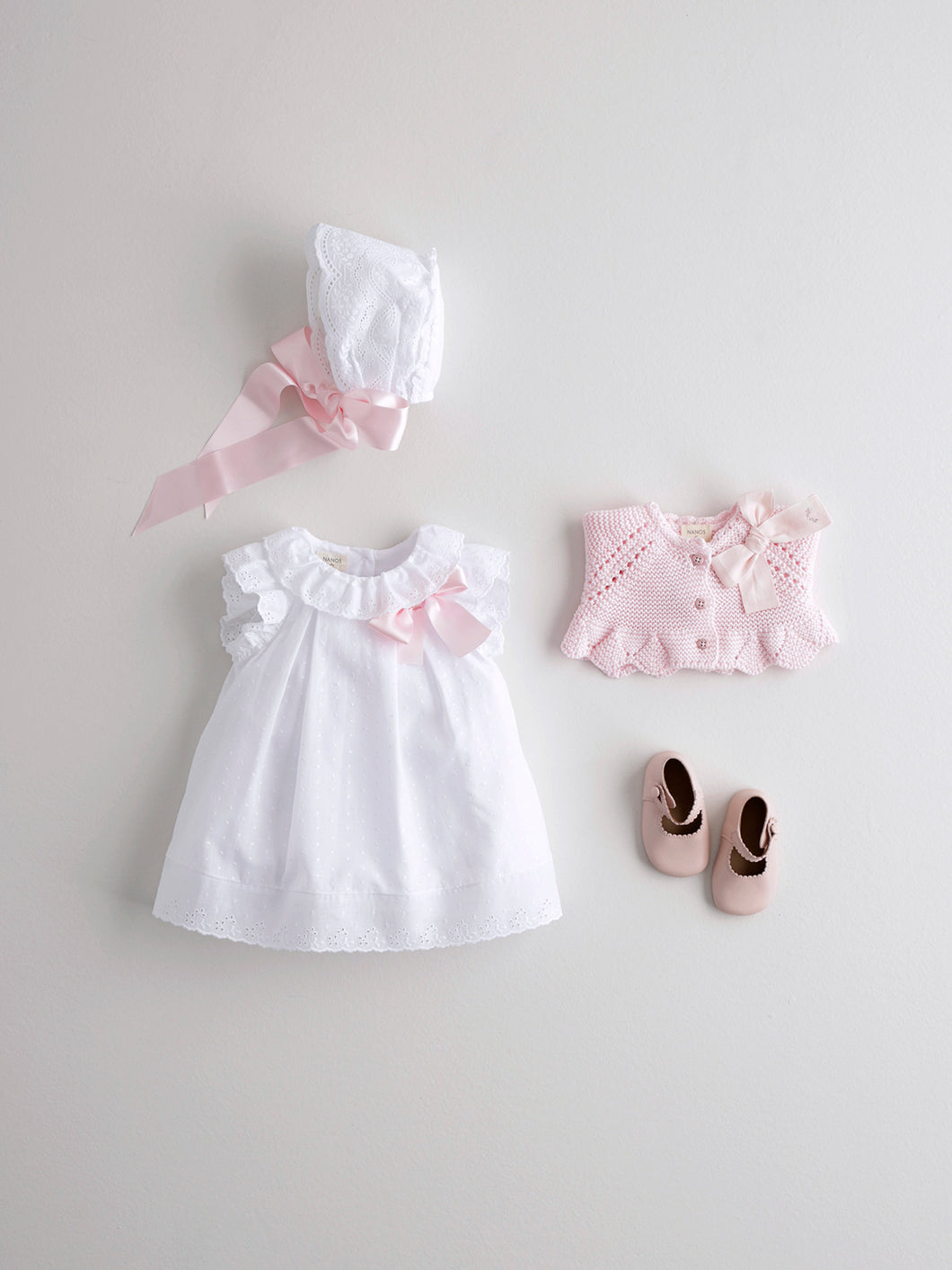 BABY GIRL DRESS IN WHITE WITH PINK BOW