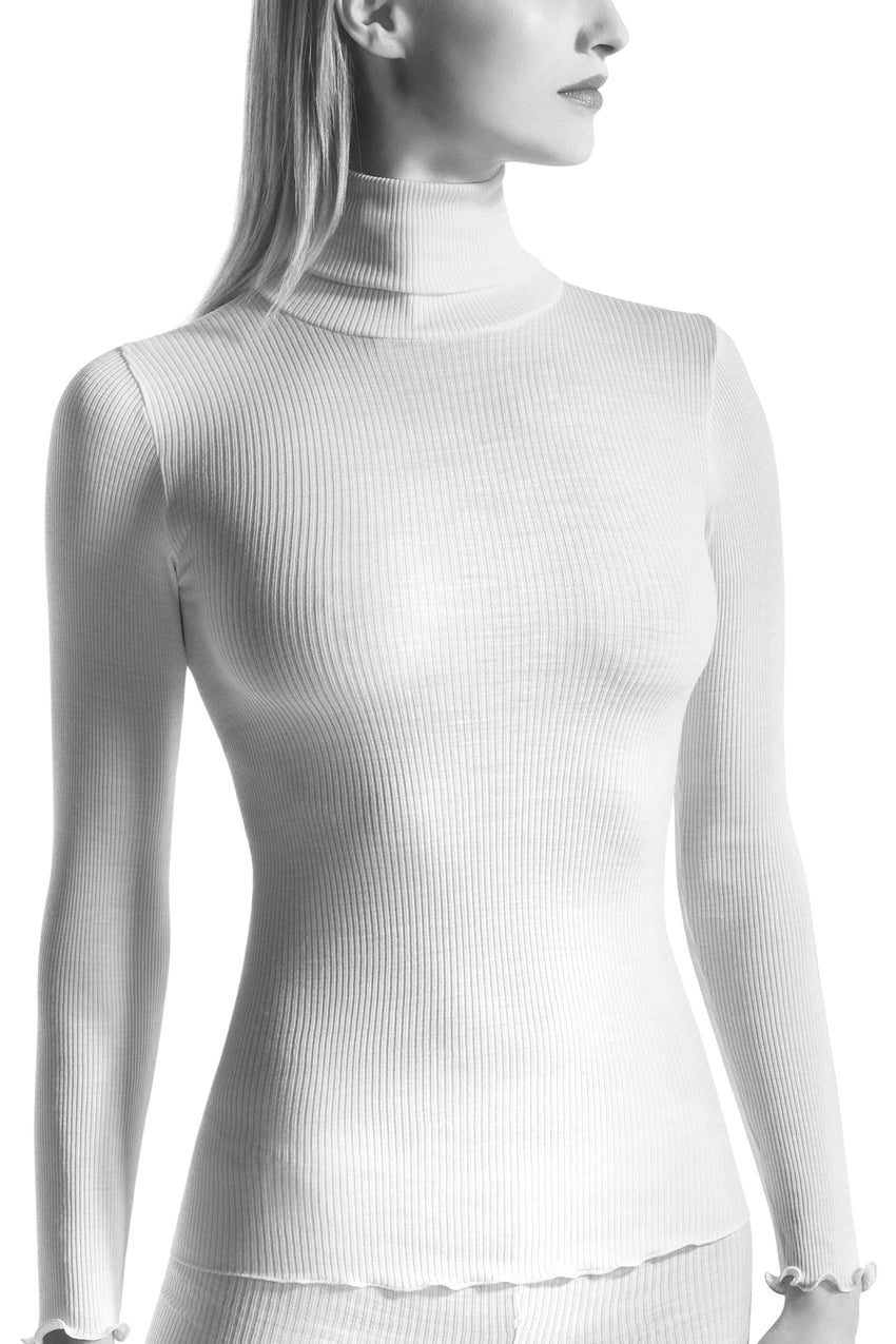 Oroblu Aurore Turtleneck A warm yet lightweight long-sleeve turtleneck with frilled trim in soft ribbed wool-silk blend.