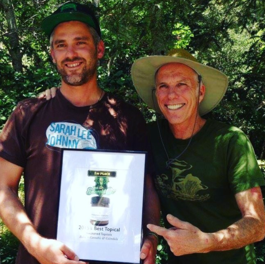 Awakened founder Levi Strom (left) with The Emerald Cup founder Tim Blake (right) in 2015 after winning 1st place for Topicals.