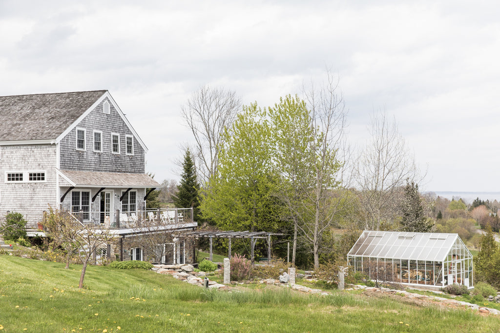 View of the Salt Water Farm farmhouse and greenhouse.
