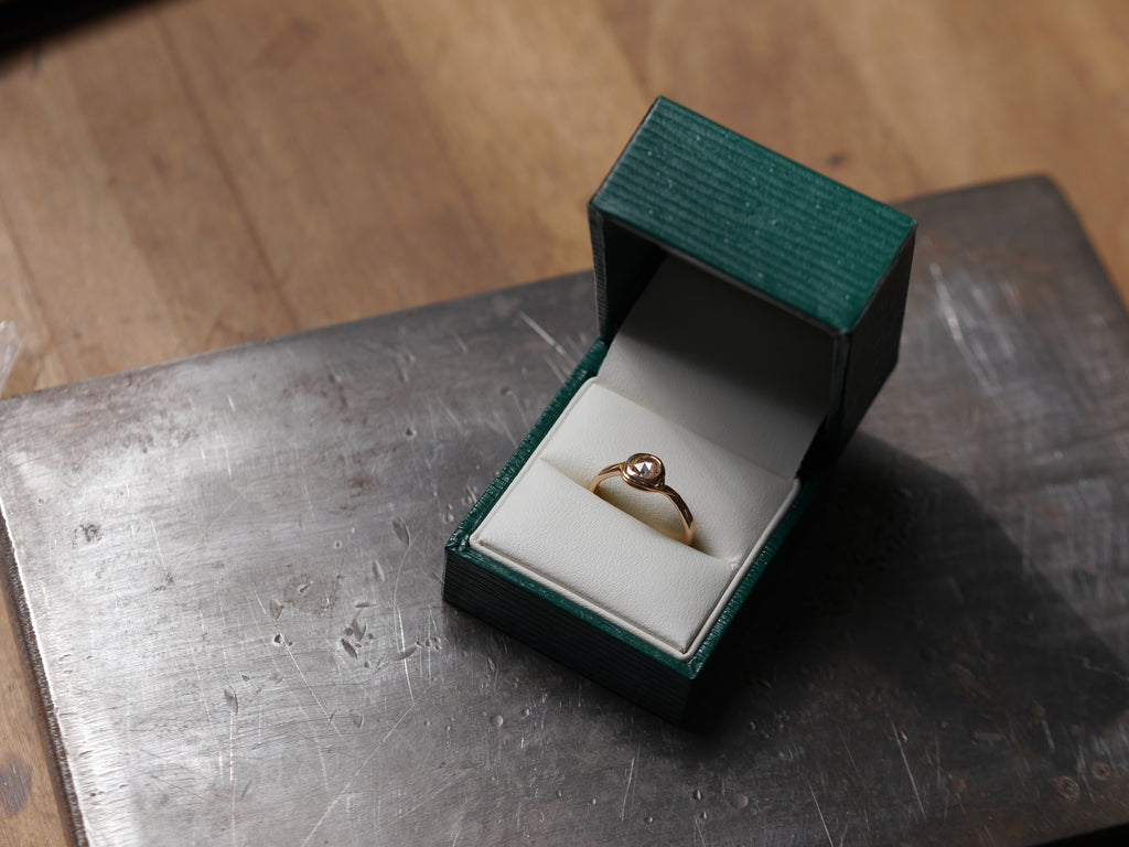 An engagement ring made on one of my Creative Jewellery Workshops. A rose cut diamond set into 18ct rose gold.