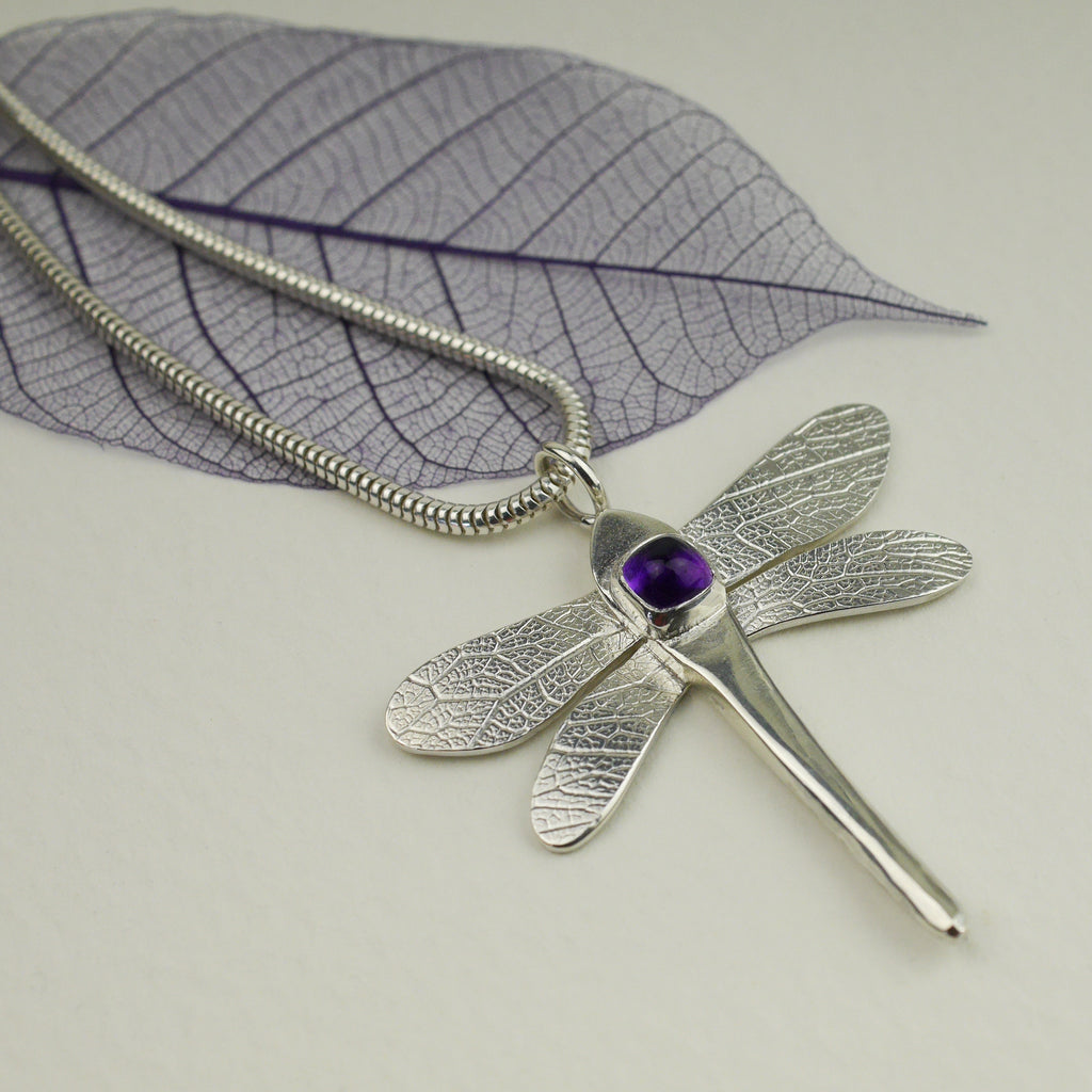 Sterling silver and amethyst dragonfly pendant, the completed piece from January's selected gemstone from the Envelope Project