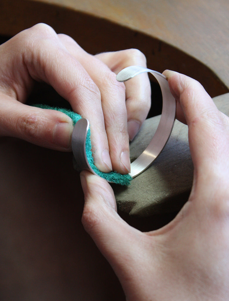 Restore a brushed silver finish on your jewellery by gently rubbing the surface with a dry scotch brite pad.