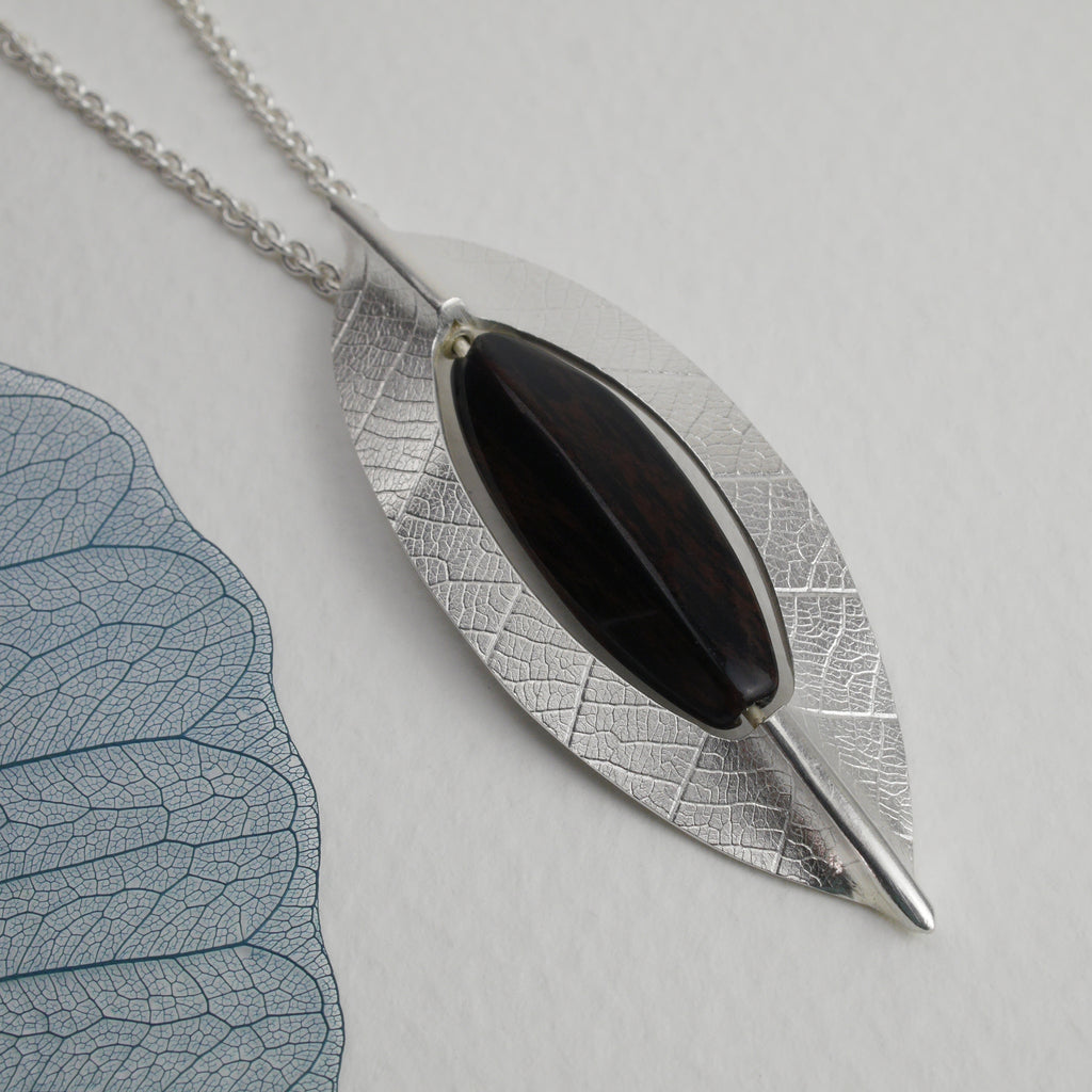 Close up of the new leaf pendant featuring the black obsidian bead which rotates, adding a lovely tactile element to this necklace