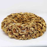 Gold wreath covered in handmade paper roses