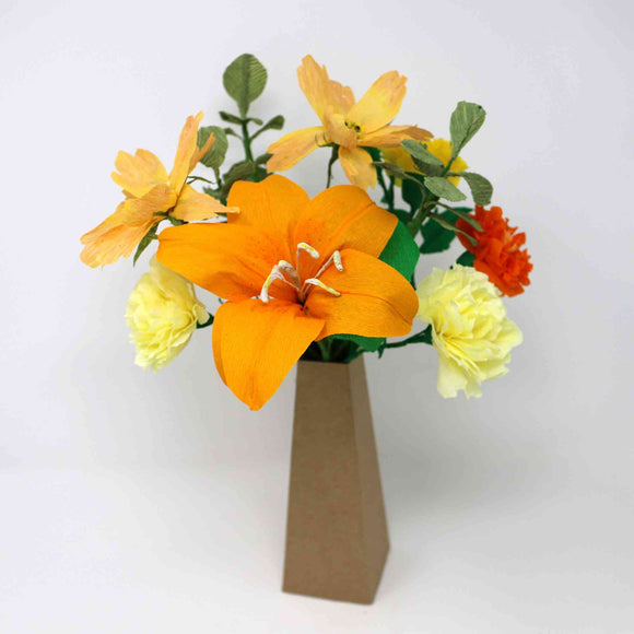 Handmade orange paper flowers in a vase