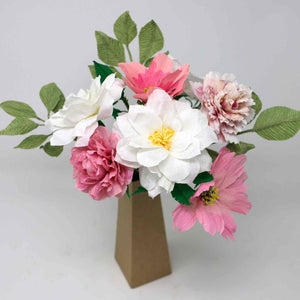Cardboard vase of handmade paper flowers in pink and white