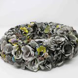 Wreath covered in newspaper roses