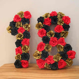 Numbers covered in handmade paper roses