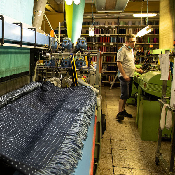 weaving the fabric for ties