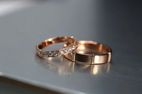 pair of gold engagement rings
