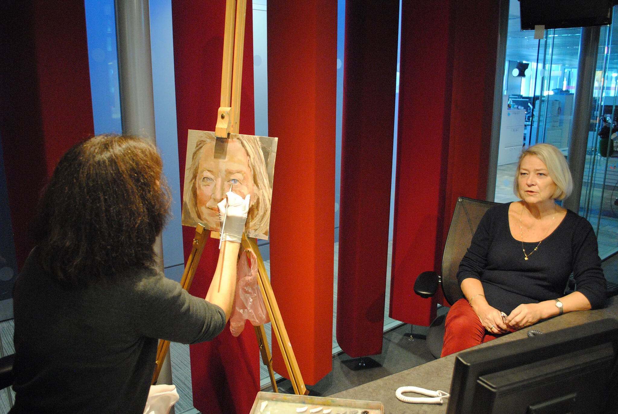 Stella Tooth painting a portrait in oils of Kate Adie in BBC Broadcasting House radio studio.