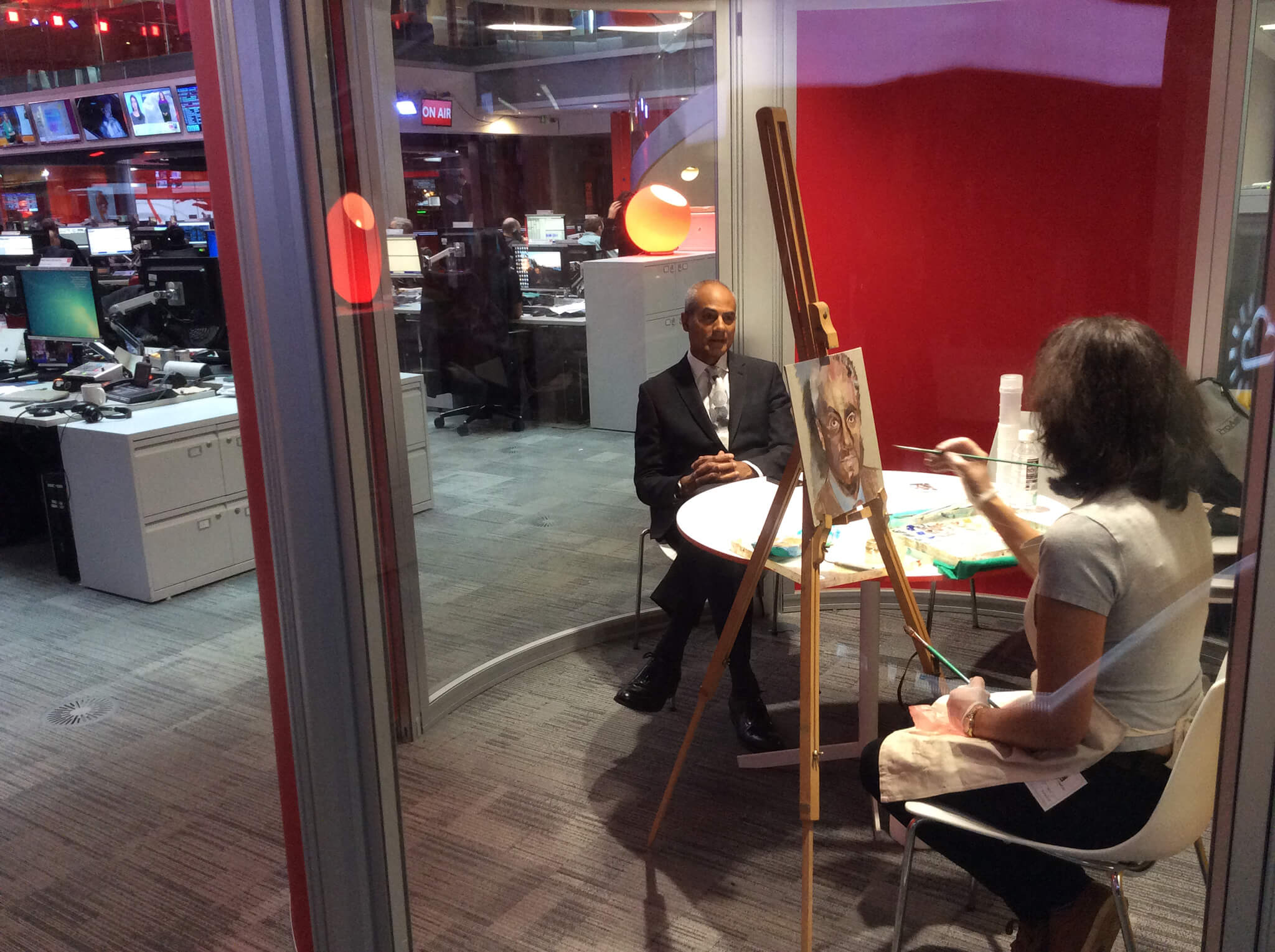 Stella Tooth painting a study of George Alagiah in oils in the BBC Newsroom.