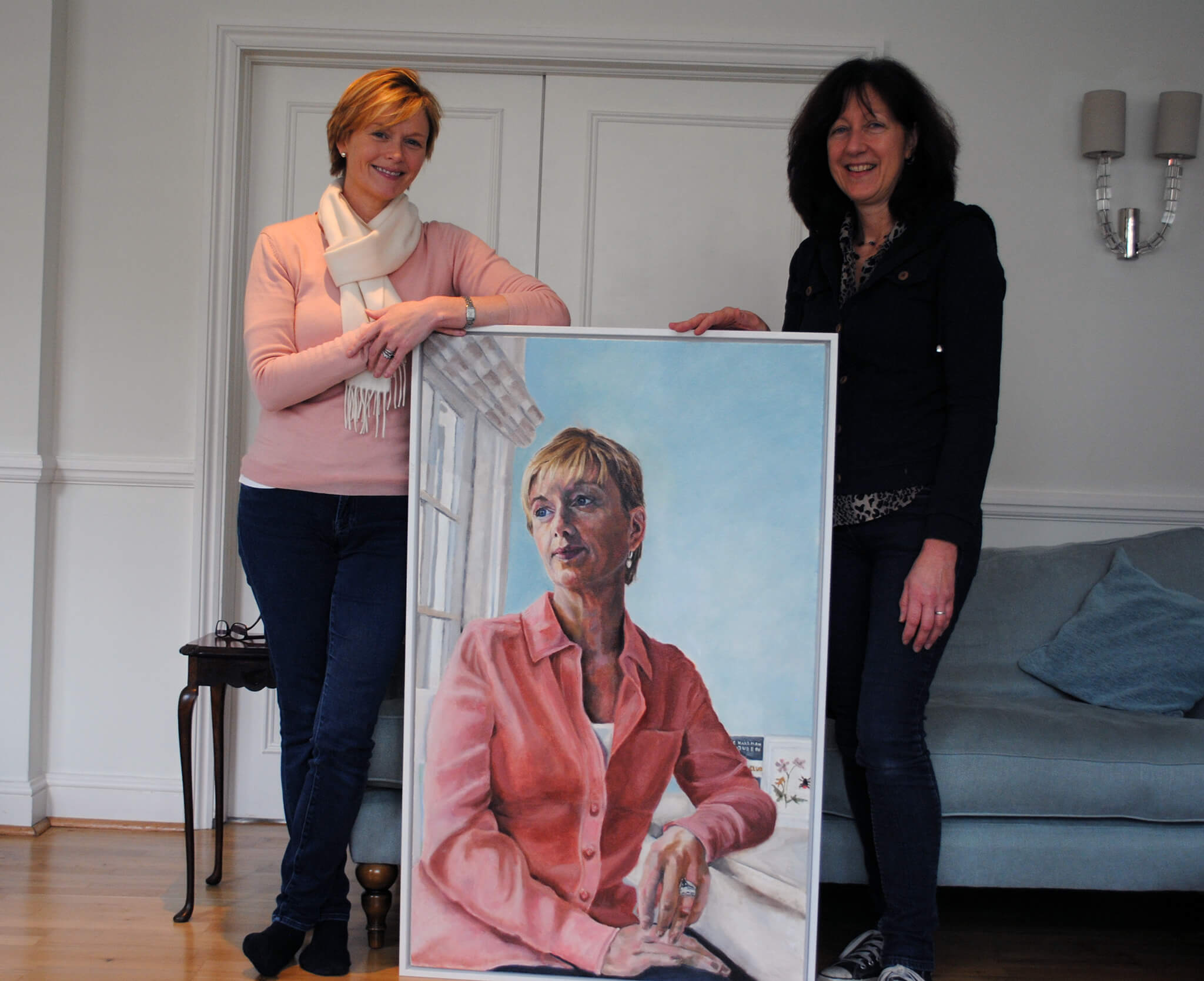 ITV News' Julie Etchingham, with artist Stella Tooth, and her portrait in oils artwork.