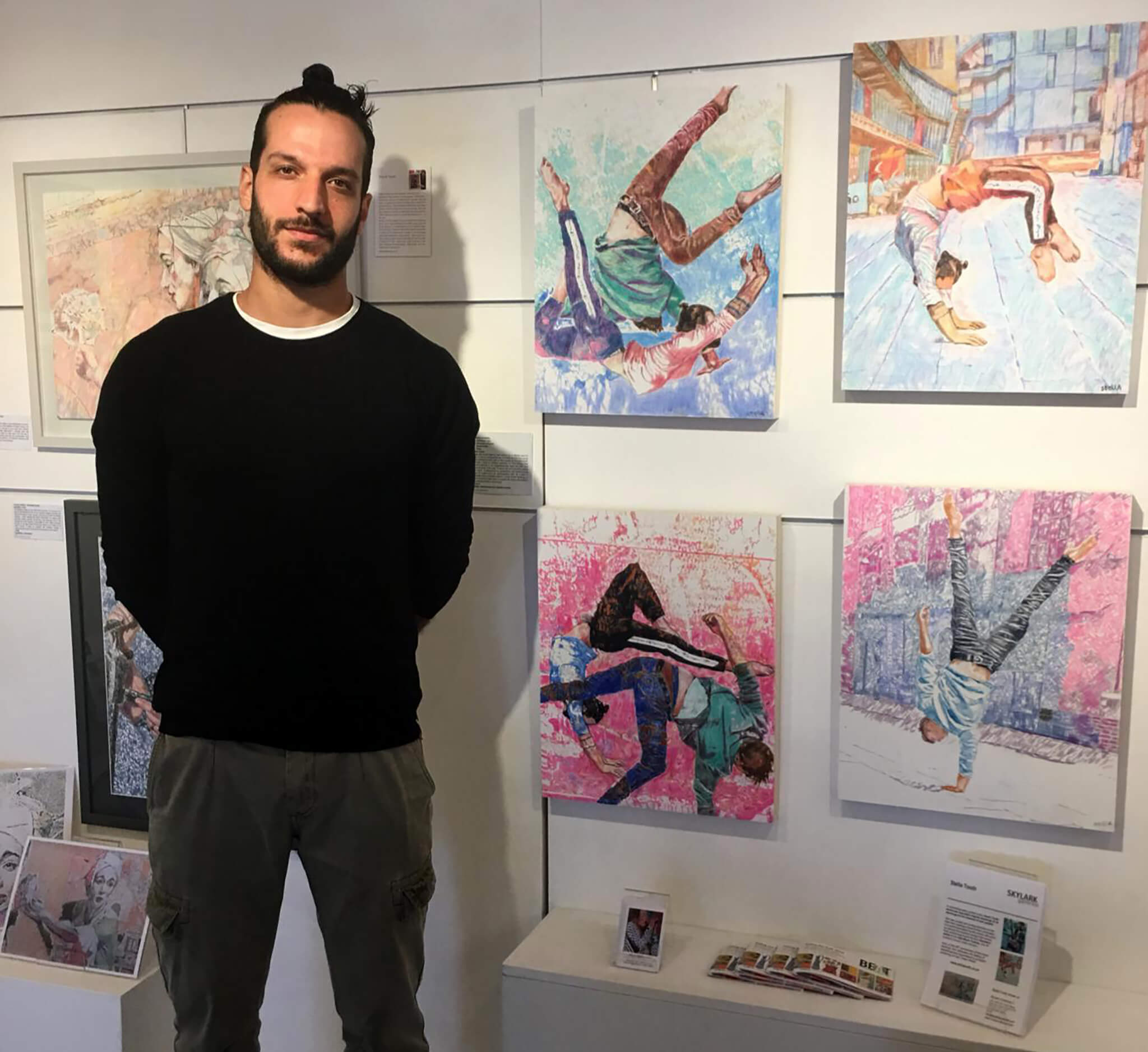 Acrobat Manuele d'Aquino at Skylark Galleries with Stella Tooth's pencil on cradled gesso panel portrait of him.