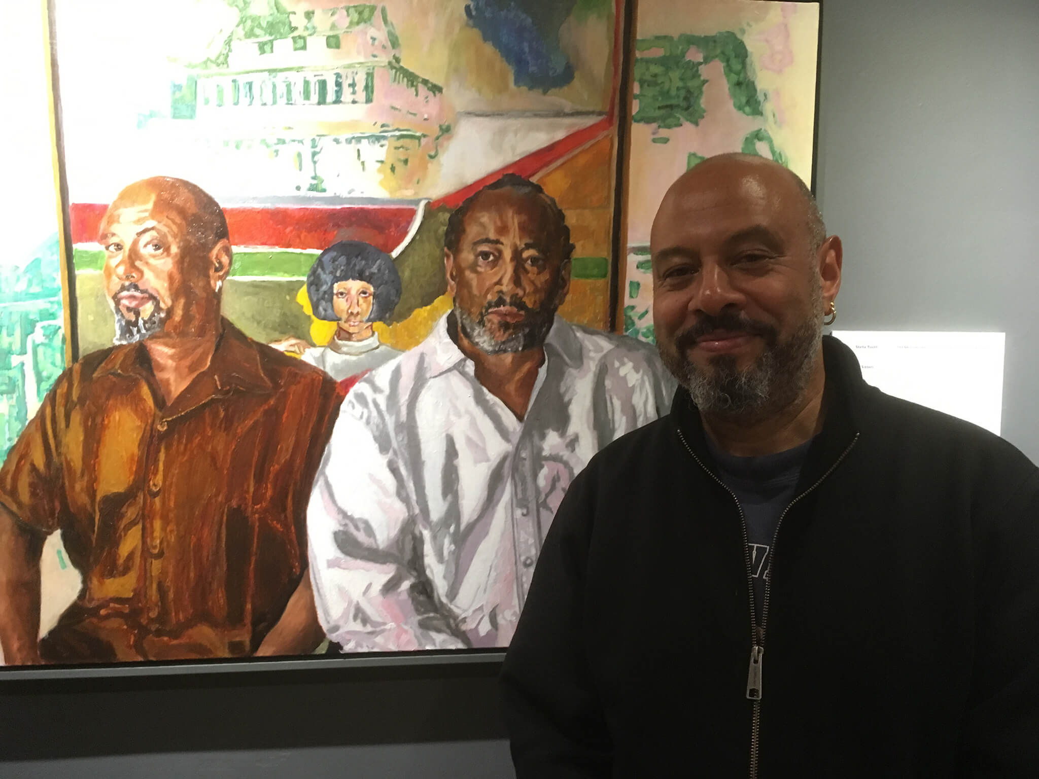 Ben with Stella Tooth's portrait of him and brother Sacha with father Frank Bowling's Cover Girl painting.