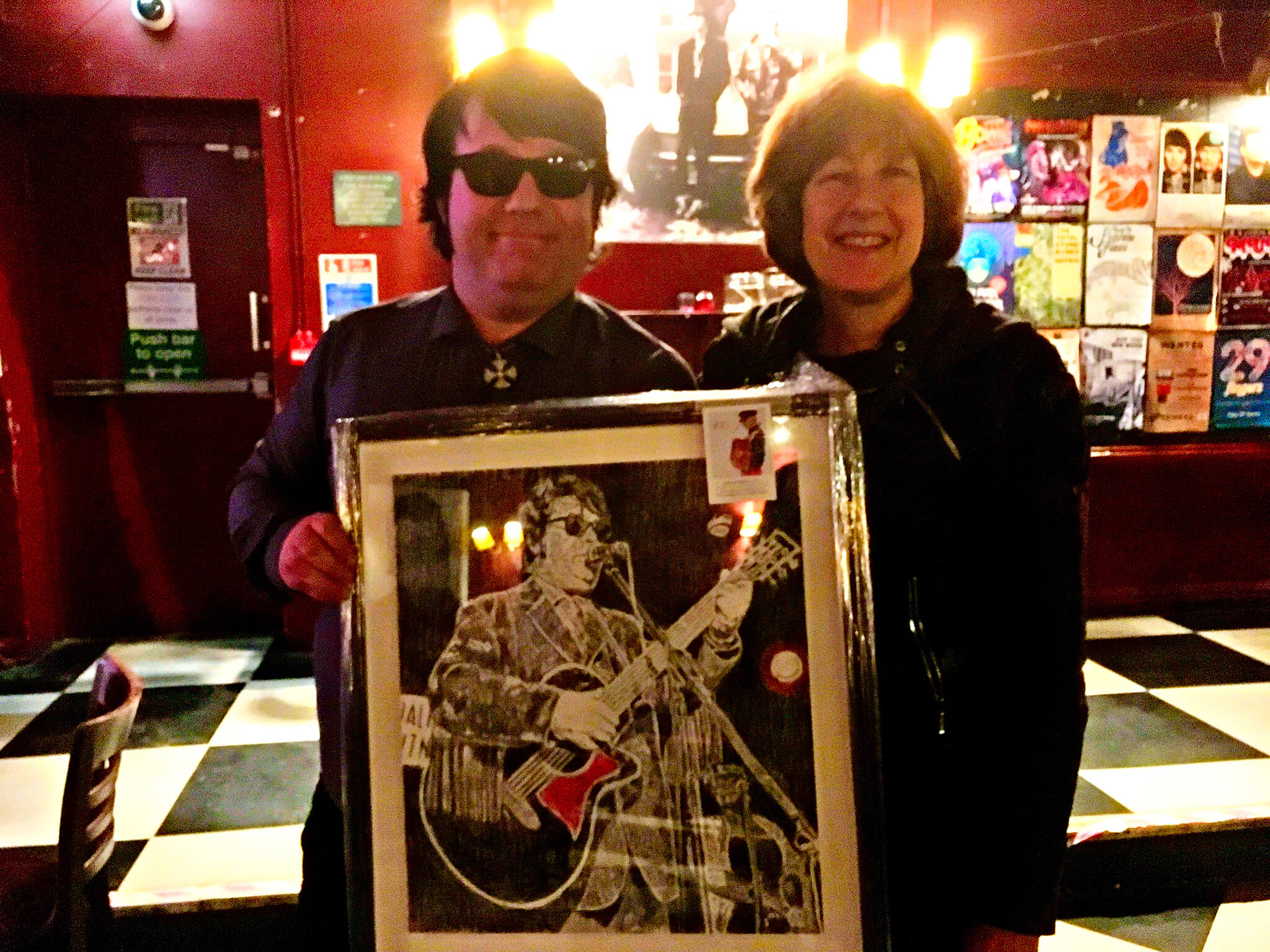 Dave Collison aka Roy Orbison with Stella Tooth and her drawn commissioned portrait of him at the Half Moon Putney.