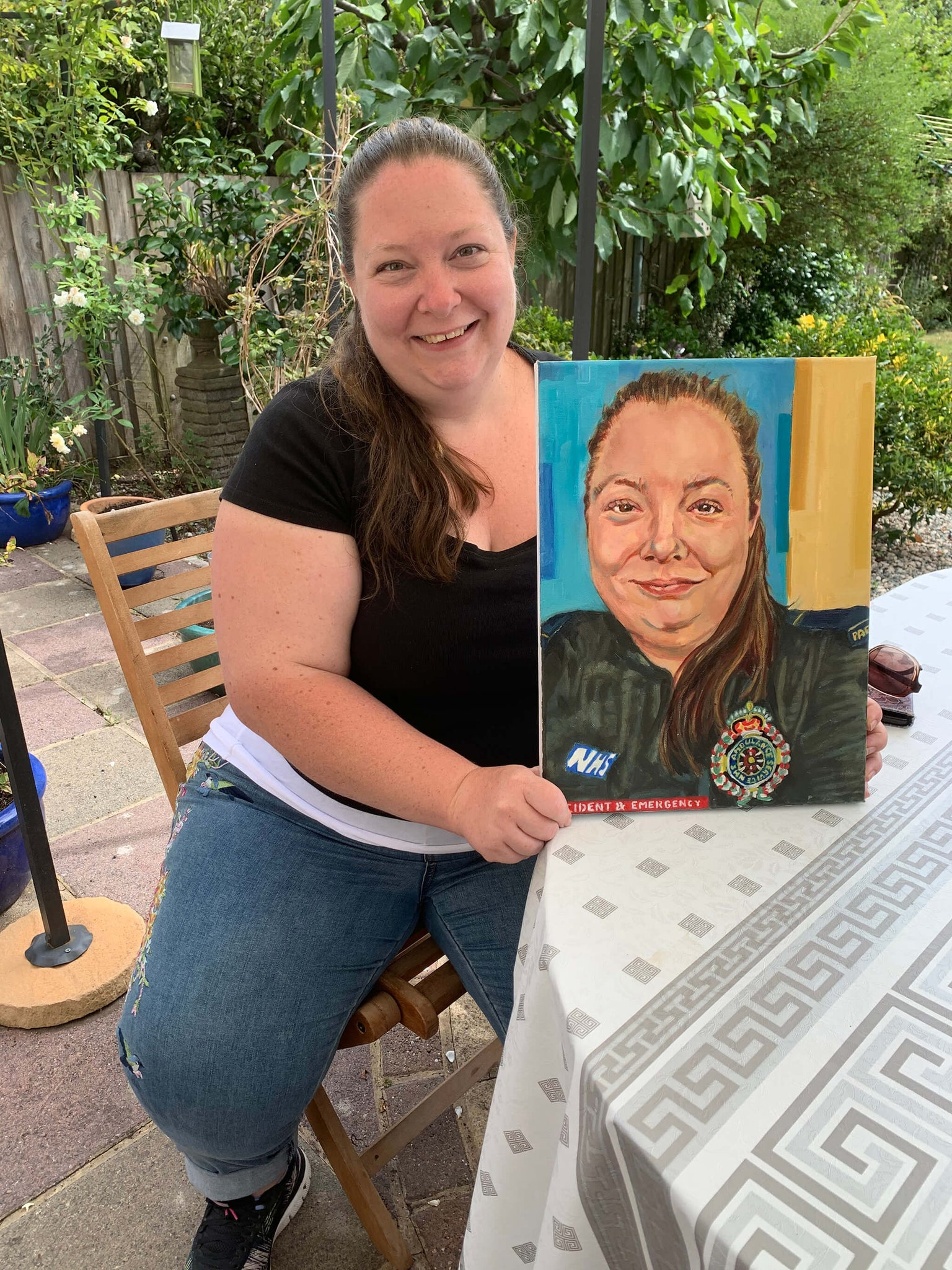 Helen Chiverton NHS Paramedic with her portrait by Stella Tooth