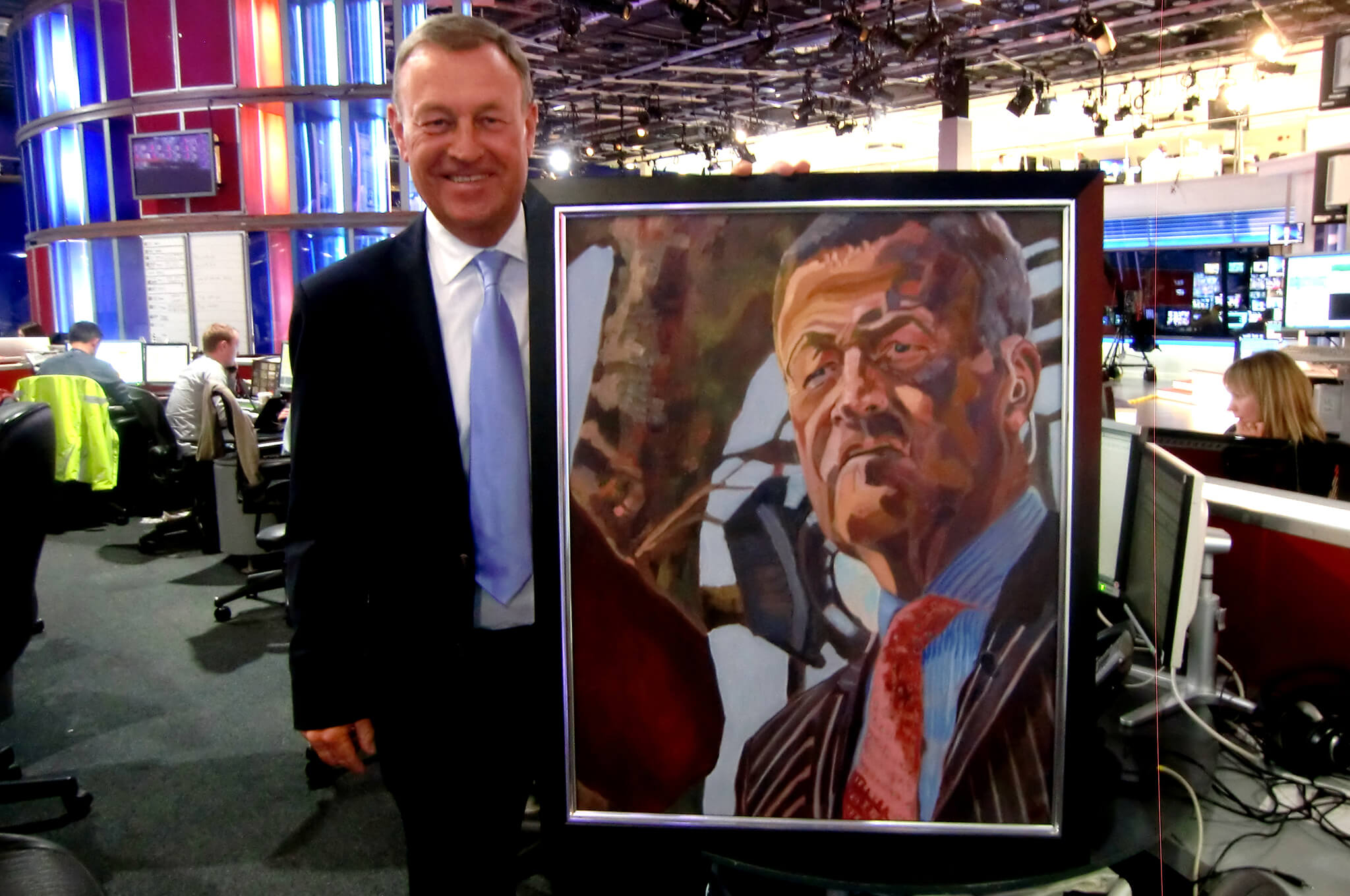 Jeremy Thomson with his student portrait in oils by Stella Tooth in the Sky Newsroom.