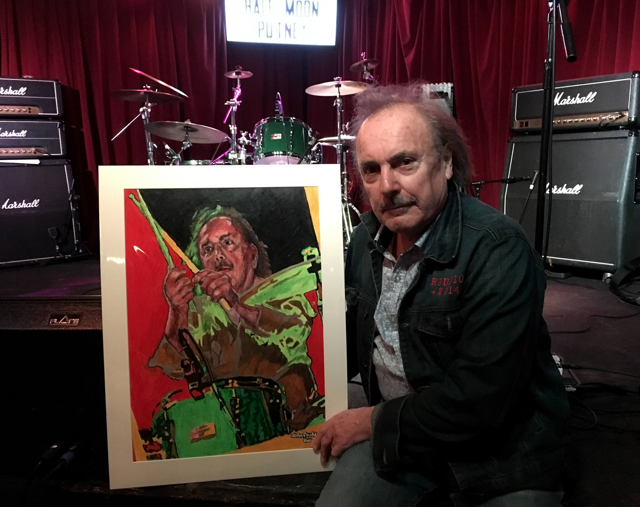 John Coghlan of John Coghlan's Quo with Stella Tooth's drawn portrait of him at the Half Moon Putney.