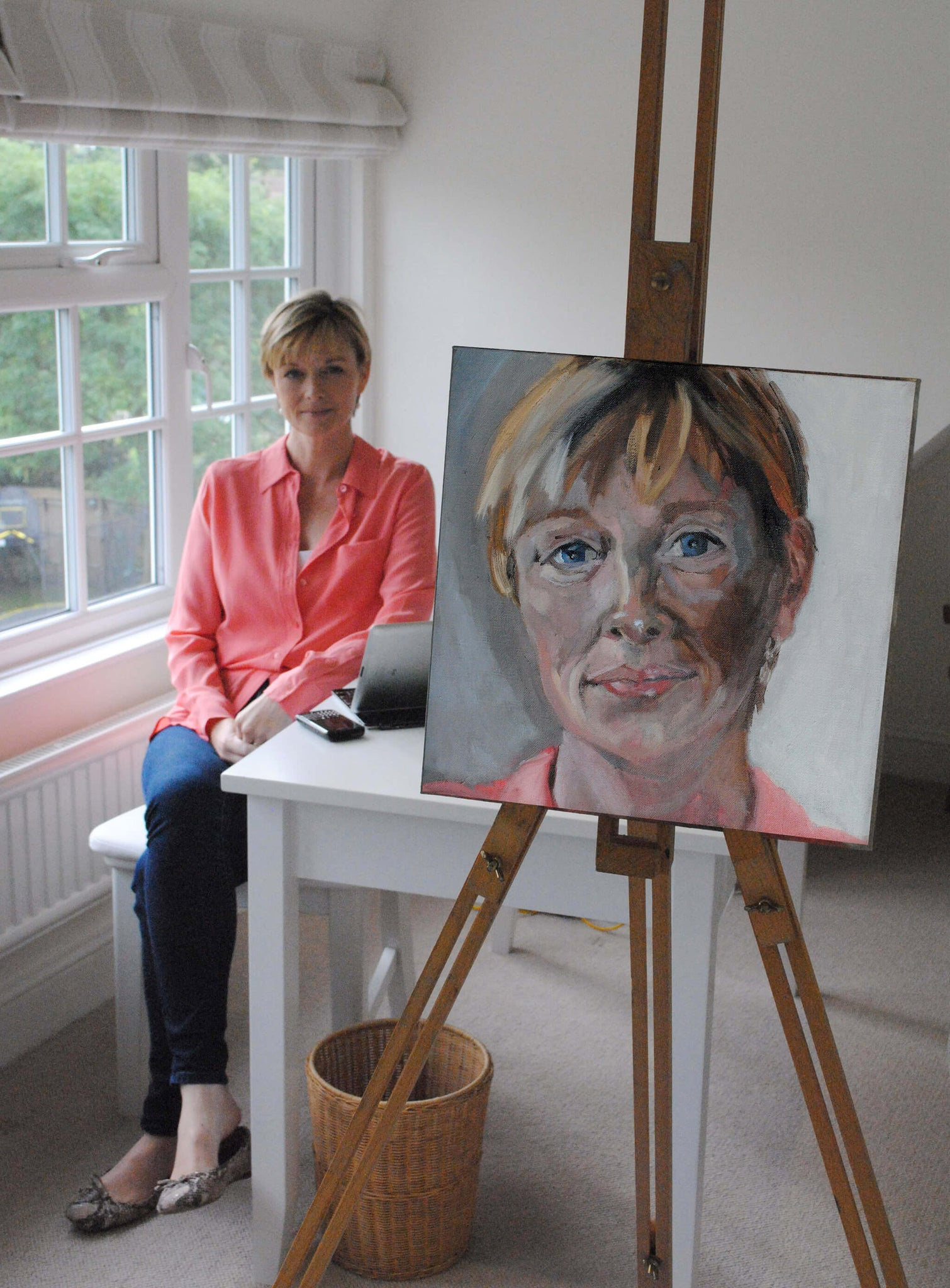 ITV News' Julie Etchingham in her home with a portrait in oils study by Stella Tooth