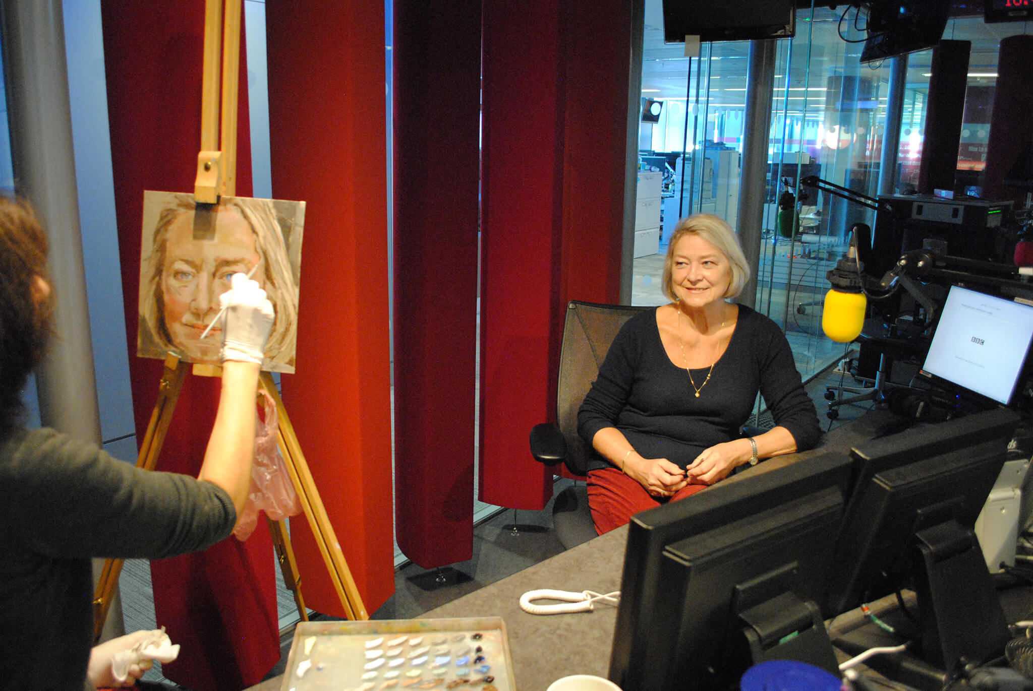 Artist Stella Tooth painting study in oils on canvas board of BBC's Kate Adie.
