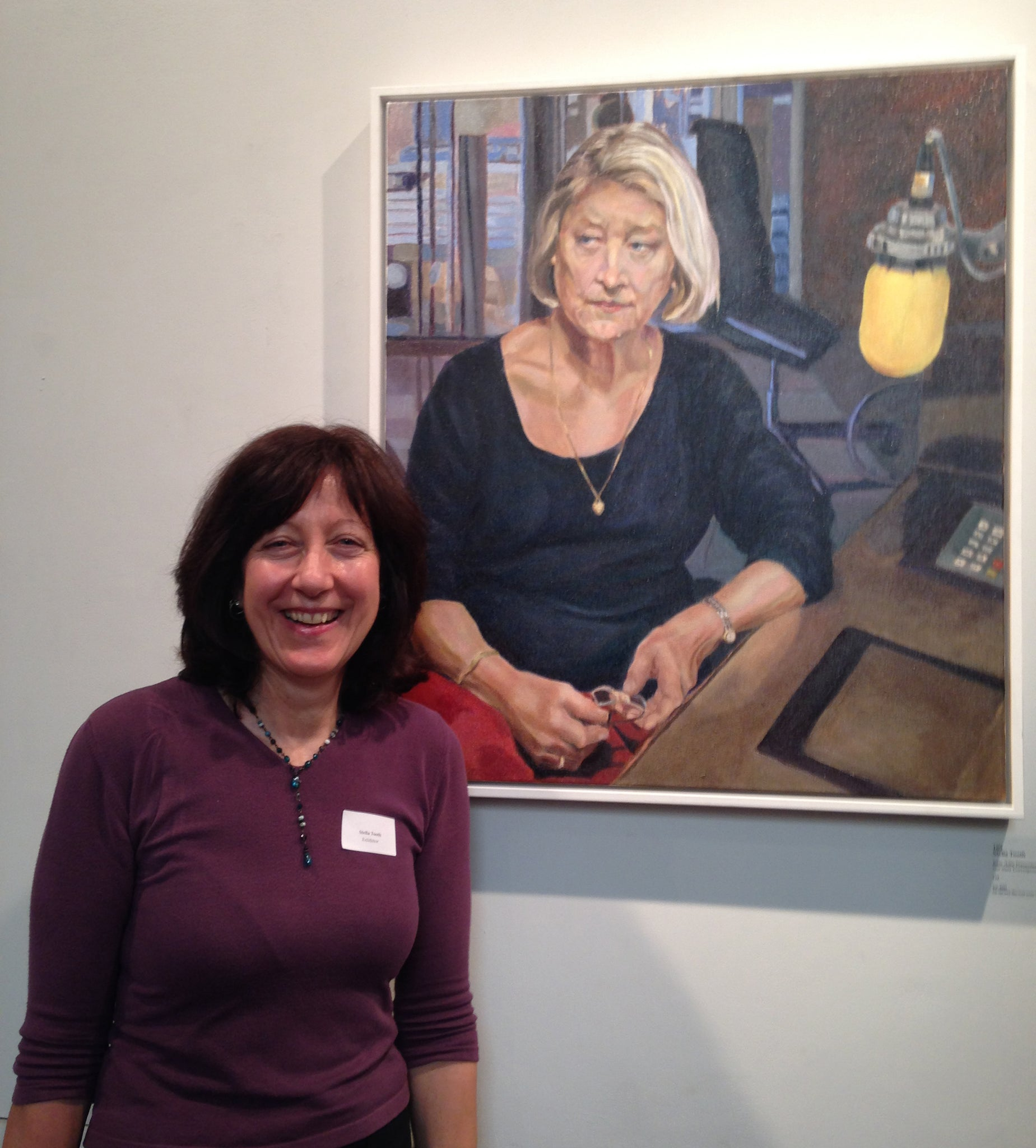Artist Stella Tooth with her oil portrait on canvas artwork of BBC's Kate Adie at Royal Society of Portrait Painters Annual Exhibition 2015.