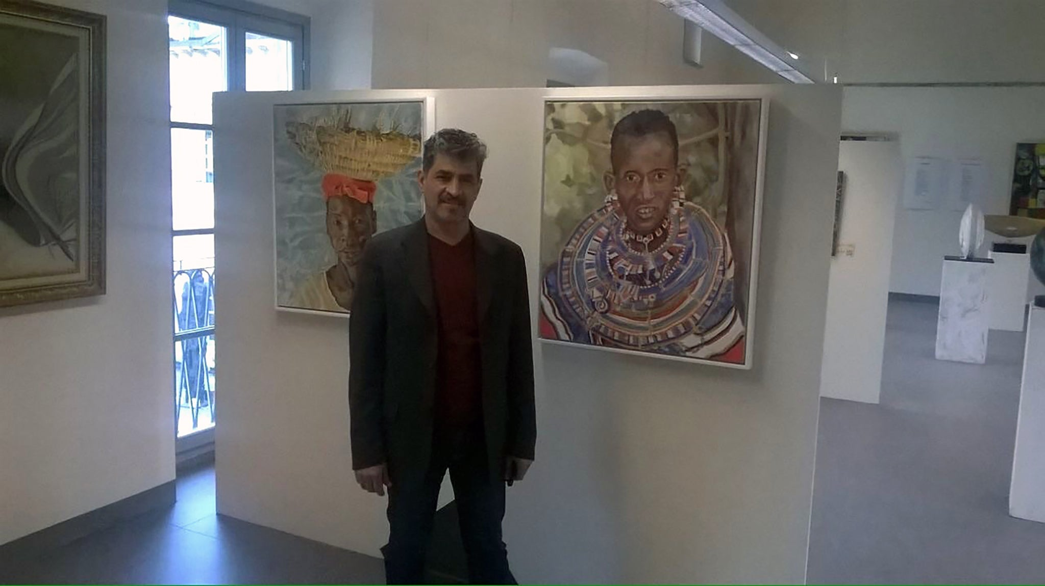 Organiser Gamal Meleka with Stella Tooth's portraits at the Milan Expo 2015.