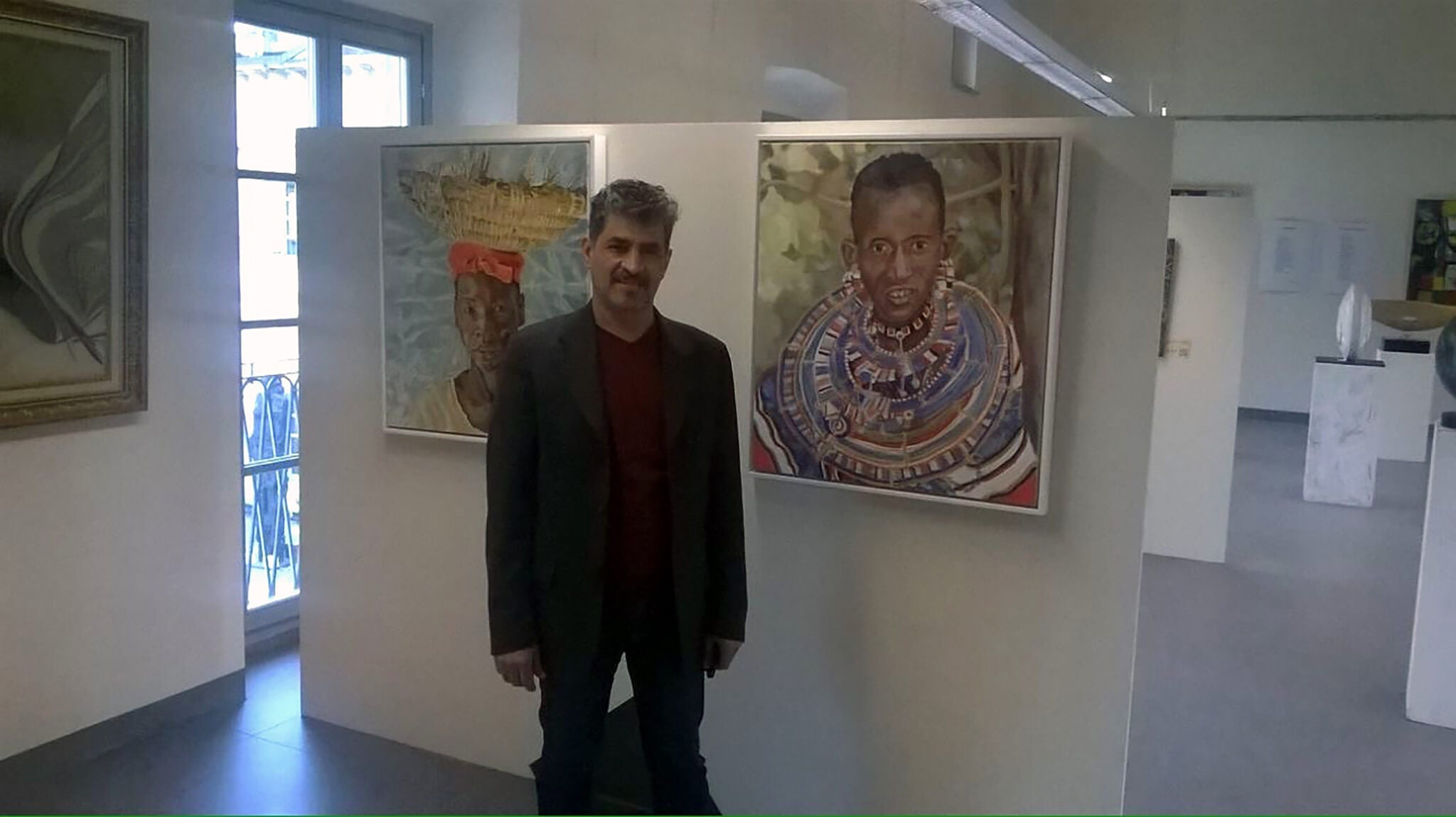 Stella Tooth's oil portraits of The Hod Carrier and Maasai woman at the Milan Expo Arte Senza Confini Soul food with organiser Gamal Meleka.