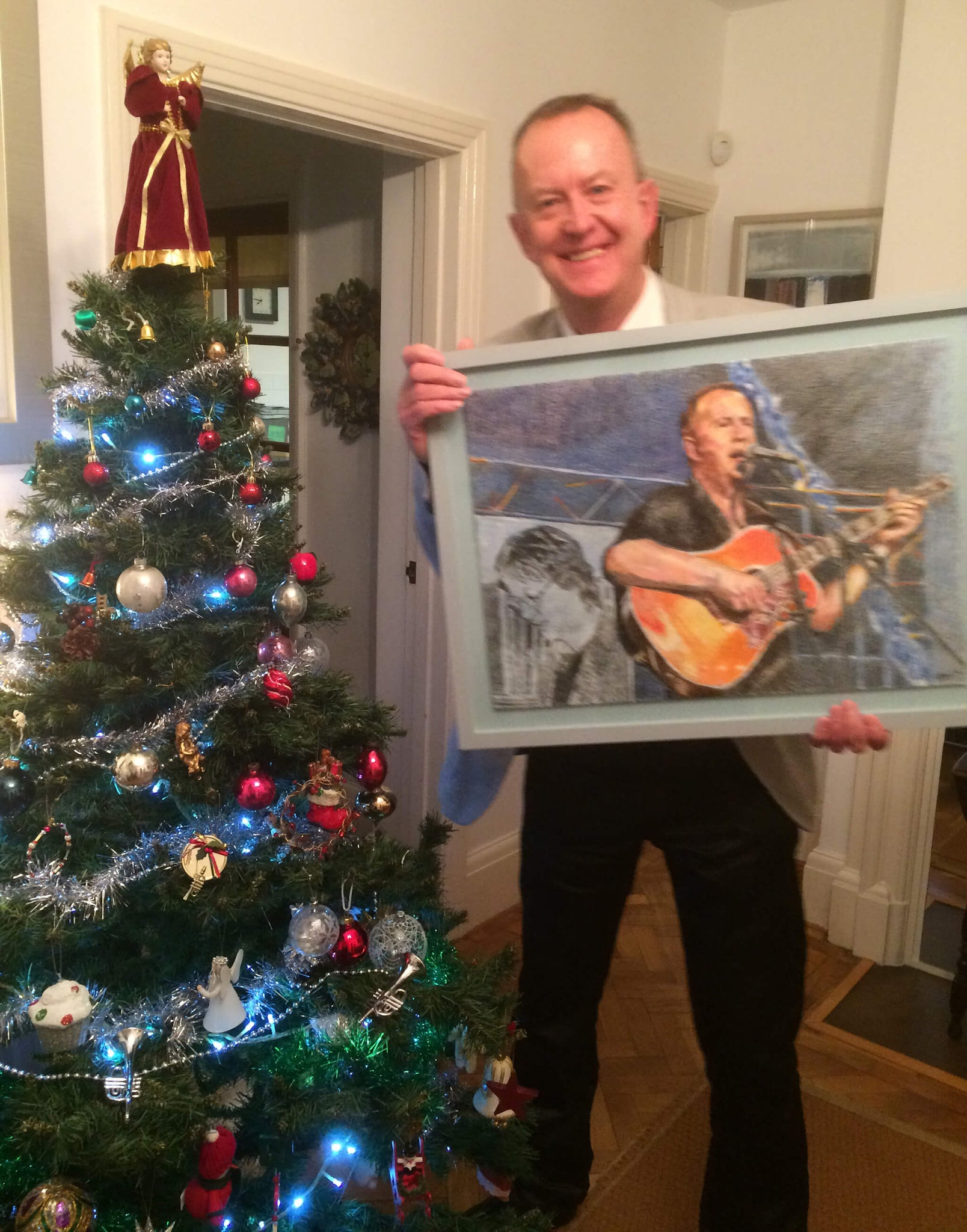 Musician Pete Whitehead with Stella Tooth's drawn portrait on paper of him in action at his retirement gig.
