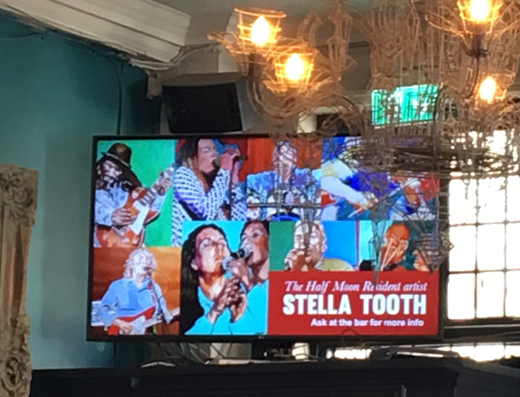 Big screen in Half Moon Putney with news of Stella Tooth as resident artist.