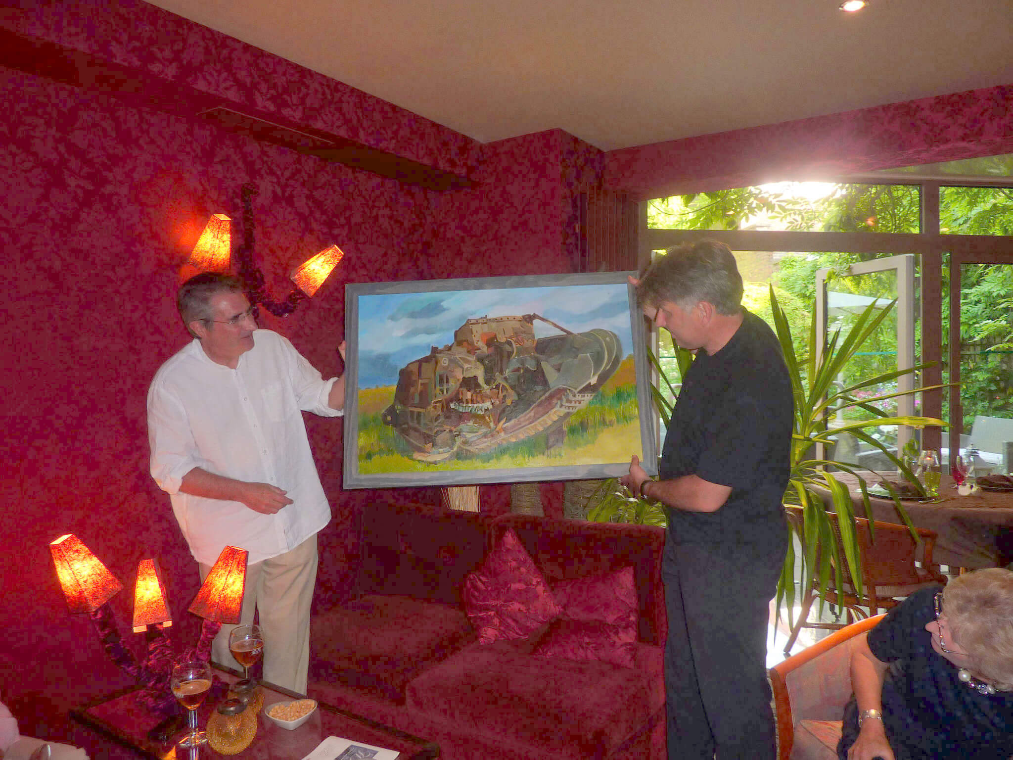 Rob Kirk and Philippe Gorczynski with Stella Tooth's oil painting Deborah WWI tank.