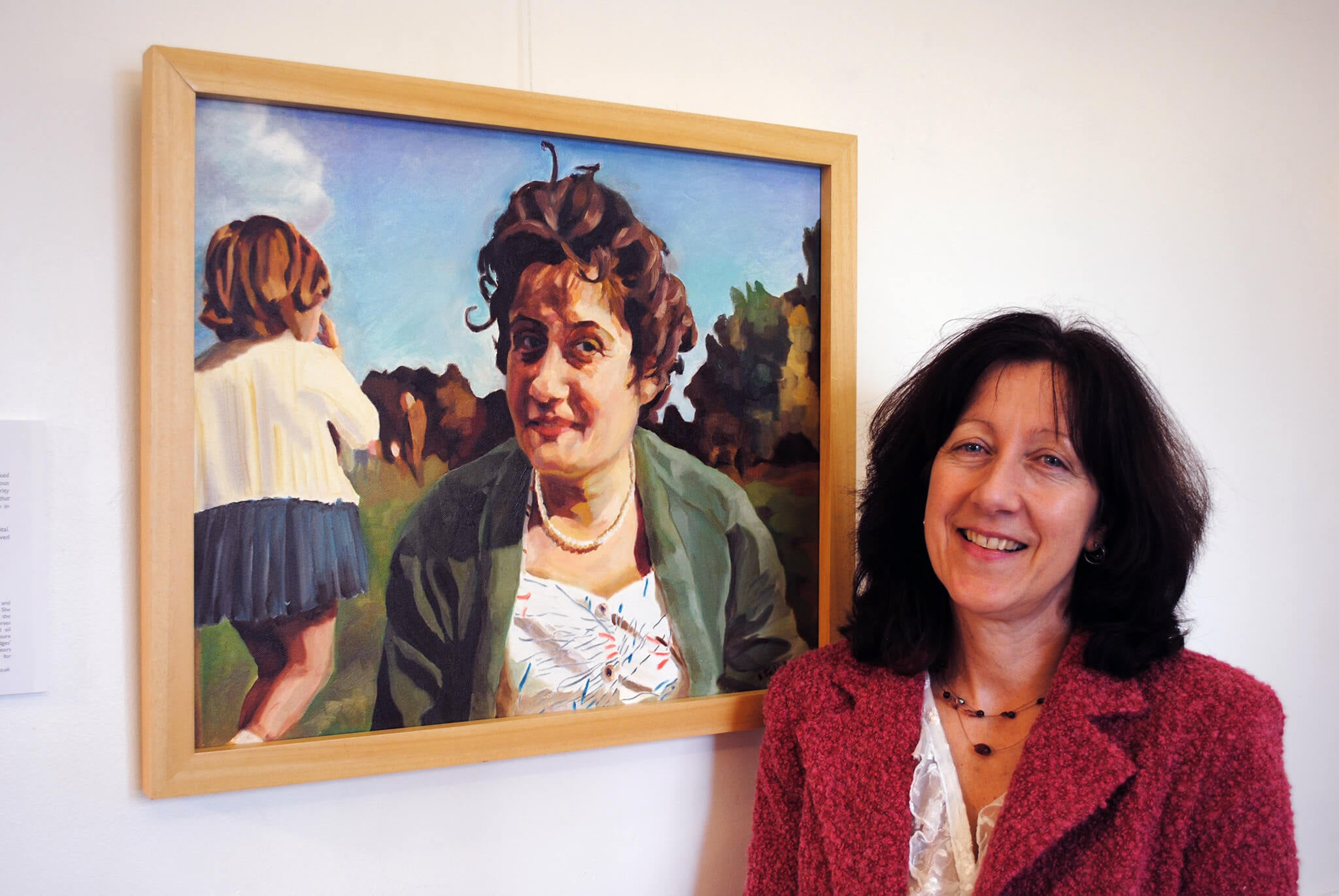 Stella Tooth and her portrait of Mum and me at the Lot's Road Group's Motherhood exhibition.