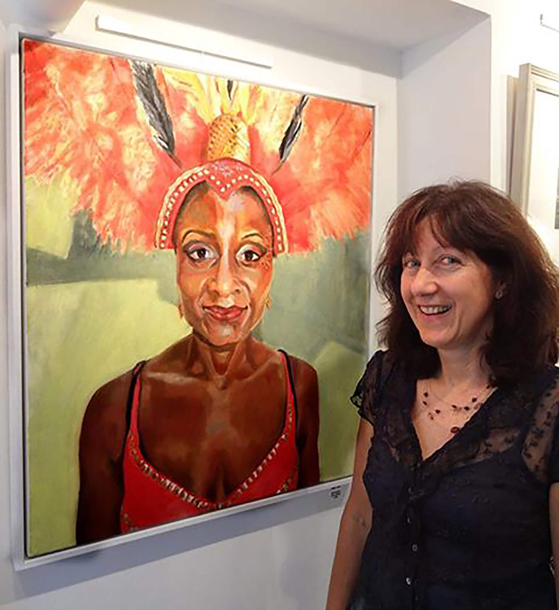 Stella Tooth with her portrait of Jumping up at The Photographer's Gallery Exhibition by David Ingham.