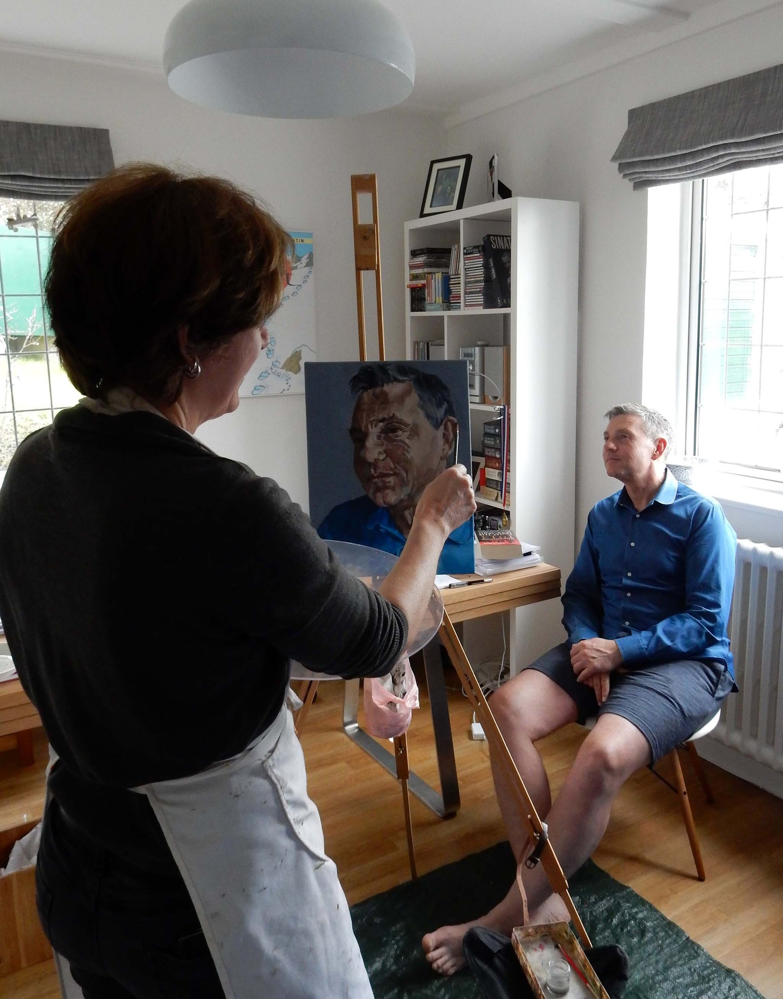 Stella Tooth painting a commissioned portrait of Martin Le Jeune in oils at his home.