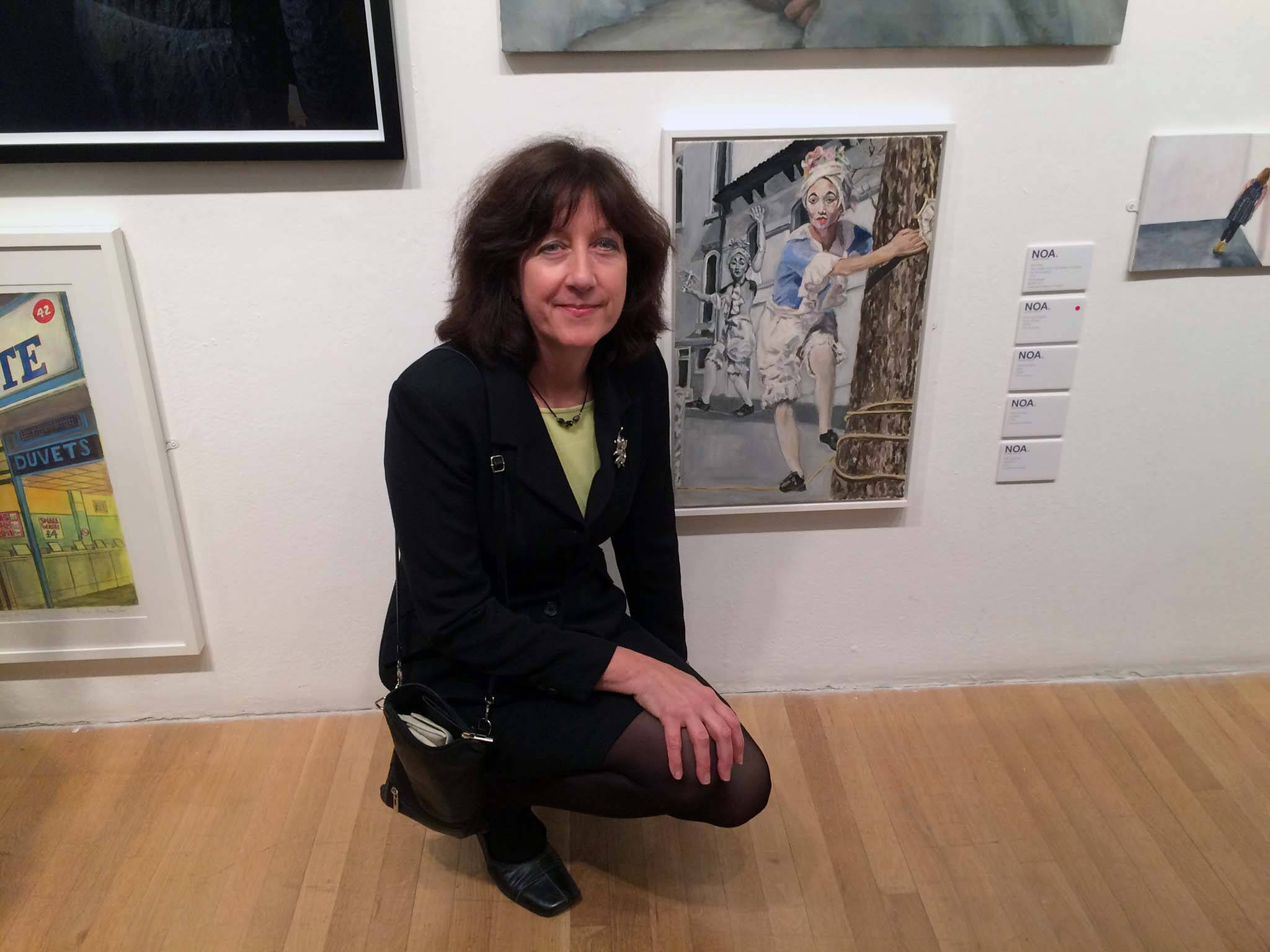 Artist Stella Tooth with her portrait of The tightrope walker at NOA 2015 at the RCA.