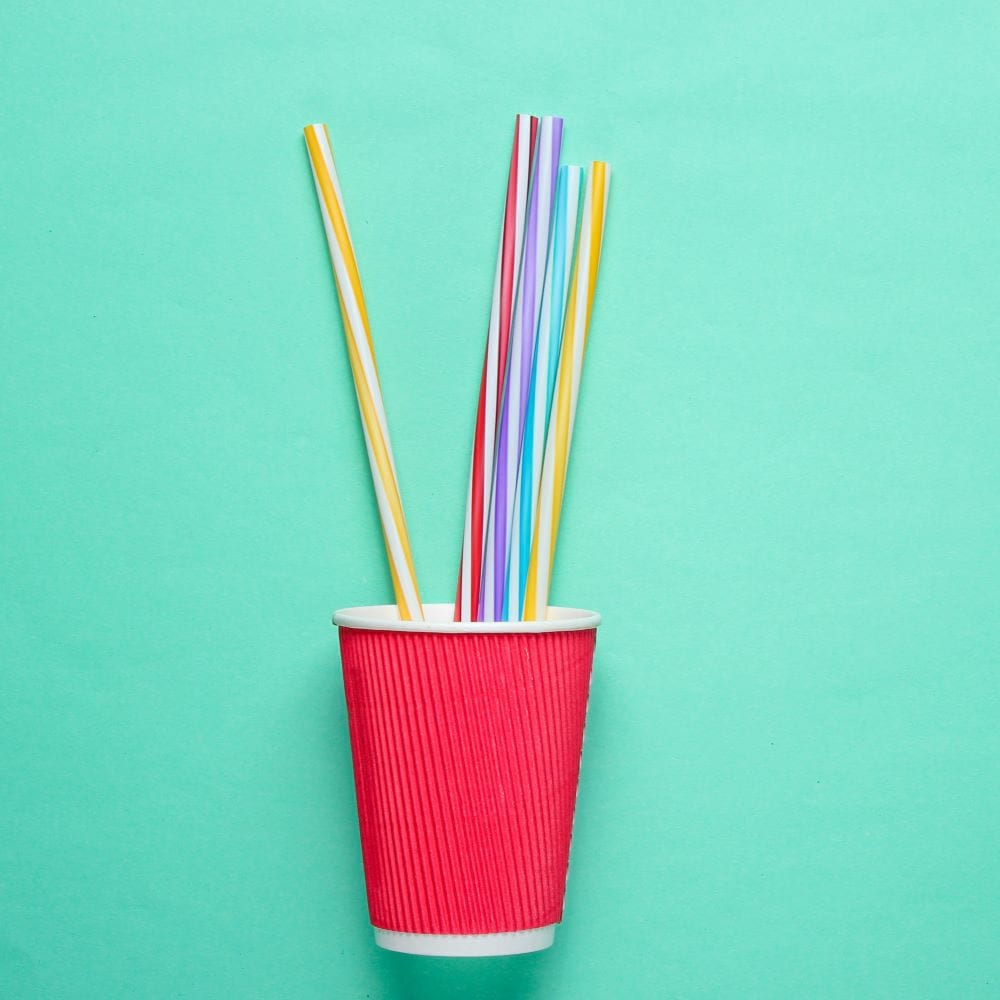 Red cardboard cup with plastic straws