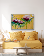 Load image into Gallery viewer, A strong abstract flower original painting for over a sofa or on its own in a dining room or hallway. Large  playful cerise flowers are intertwined with small lavender flowers against a  gold metallic background displayed in a bedroom setting.