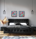 Load image into Gallery viewer, Painting shown above a grey bed. Paired with Melody of Spring