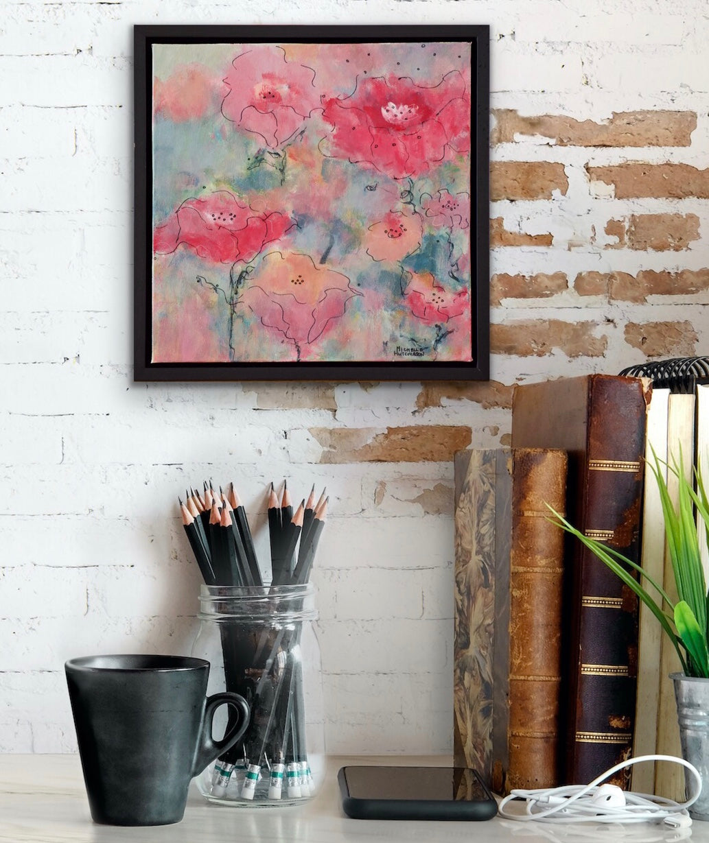 Displayed on a white brick wall above a desk. Abstract flowers in reds, pinks, and corals against a background of blue greens is bursting with colourful personality in this original painting!