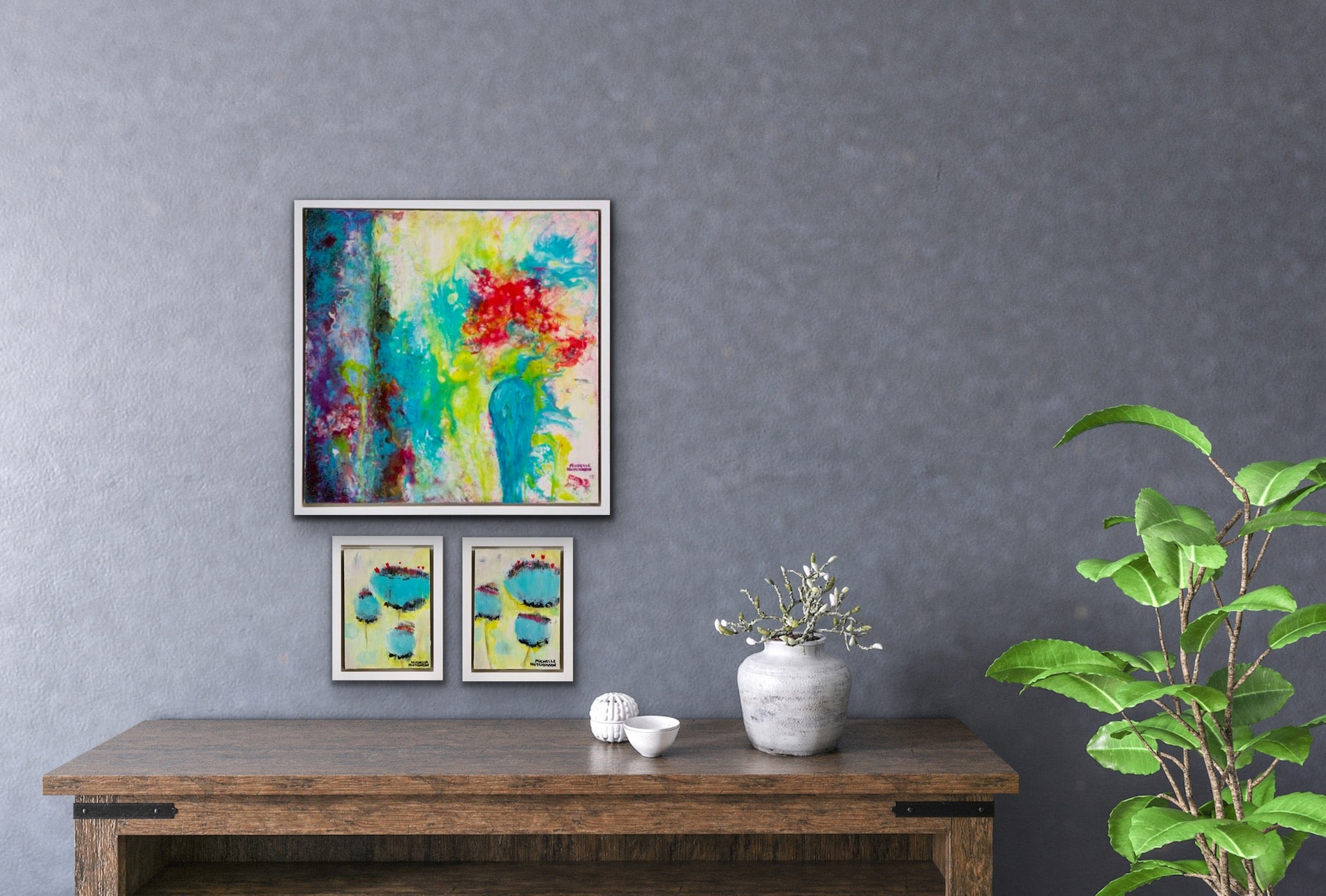 Offbeat and playful, this joyful original painting uses a technique called acrylic pouring. The red flowers sit within a teal vase beside blue drapes, inviting the viewer to gaze into the heart of love. It has a glossy finish. Displayed on a grey wall with two mini paintings above a console table.